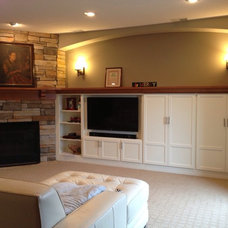 Traditional Basement by Brinkman Russell, Inc.
