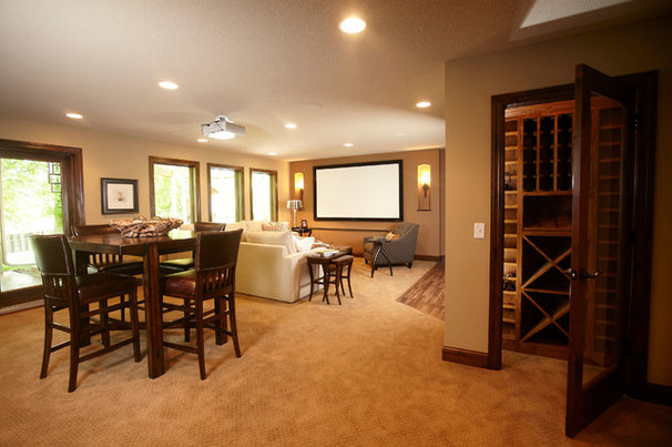 Traditional Basement by Schrader & Companies