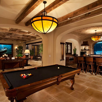 Example of a mid-sized classic underground ceramic tile and brown floor basement design in Orange County with beige walls and no fireplace