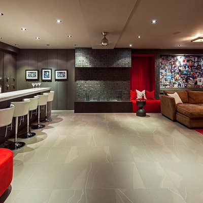 Inspiration for a contemporary underground ceramic tile and gray floor basement remodel in Toronto with gray walls and no fireplace