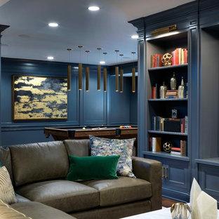 Idées déco pour un grand sous-sol classique semi-enterré avec un mur gris, un sol en bois foncé, aucune cheminée et un sol marron.