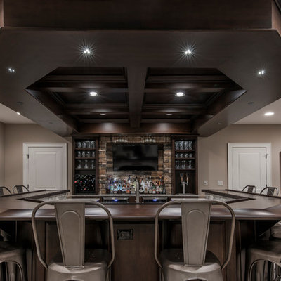 Inspiration for a transitional basement remodel in Columbus with beige walls