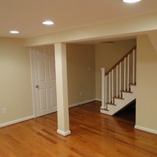 Traditional Basement by Midas Construction