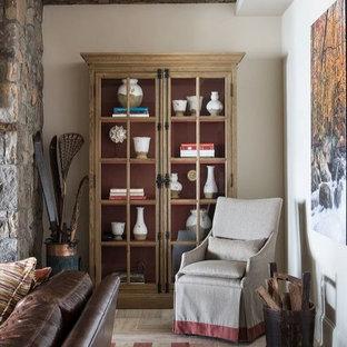 Cette photo montre un grand sous-sol chic donnant sur l'extérieur avec un mur beige, un sol en calcaire et une cheminée standard.