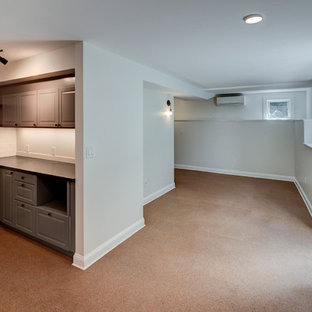 Medium sized contemporary walk-out basement in Boston with grey walls and cork flooring.