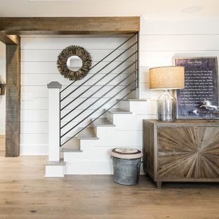 Basement - mid-sized modern walk-out light wood floor basement idea in Atlanta with white walls