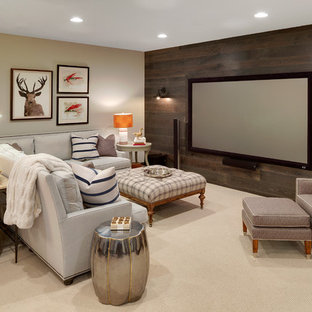 This is an example of a large country fully buried basement in Minneapolis with beige walls and carpet.