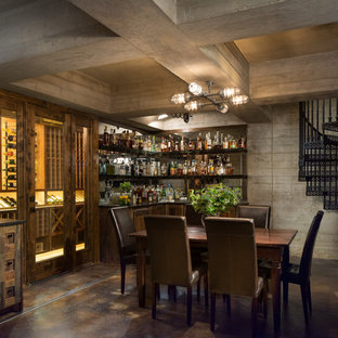 Example of a large mountain style underground concrete floor basement design in Austin with gray walls and no fireplace