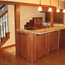 Traditional Basement by Red House Remodeling