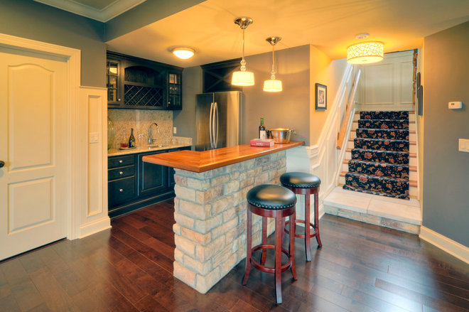 Traditional Basement by Liston Construction Company, Inc.