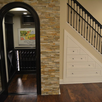 Wine room and drawers under the stairs