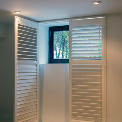 this is the basement laundry room where we added a simple shutter to