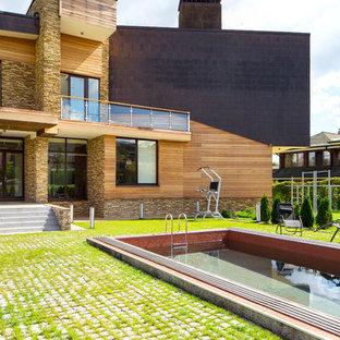 Идея дизайна: спортивный, прямоугольный бассейн на заднем дворе в современном стиле