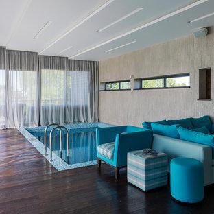 Неиссякаемый источник вдохновения для домашнего уюта: прямоугольный бассейн в доме в современном стиле