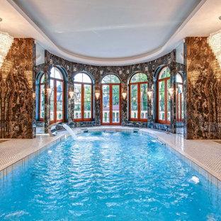 Diseño de piscina con fuente alargada, tradicional, interior y a medida