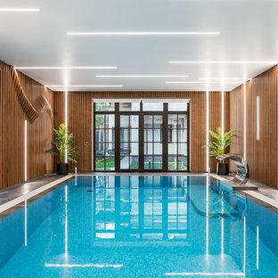 Создайте стильный интерьер: большой прямоугольный бассейн в доме в современном стиле - последний тренд