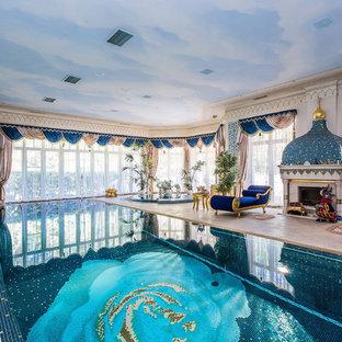 На фото: прямоугольный бассейн в доме в восточном стиле с джакузи и покрытием из плитки с