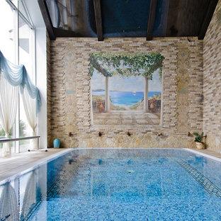 Новые идеи обустройства дома: спортивный, прямоугольный бассейн в средиземноморском стиле с фонтаном