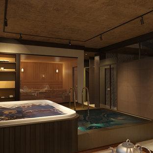 Ispirazione per una grande piscina coperta naturale nordica rettangolare con una vasca idromassaggio e piastrelle