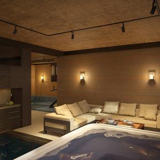 Idées déco pour une grand piscine intérieure naturelle scandinave rectangle avec un bain bouillonnant et du carrelage.