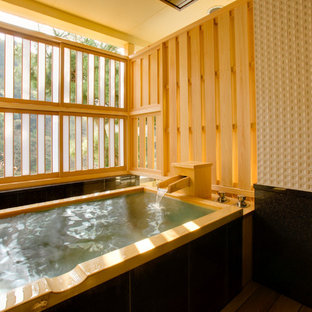 Inspiration for an asian bathroom in Tokyo with a japanese tub.