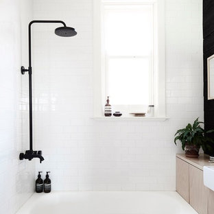 Example of a small danish master white tile bathroom design in Other with white walls and a vessel sink