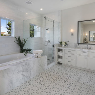 Transitional master white tile gray floor bathroom photo in Orange County with shaker cabinets, white cabinets, gray walls, an undermount sink, a hinged shower door and white countertops
