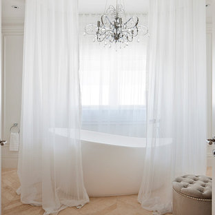 Mid-sized transitional master porcelain tile freestanding bathtub photo in Melbourne with white walls