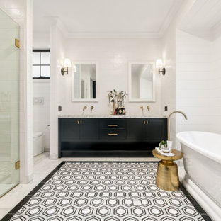 Country bathroom in Brisbane with shaker cabinets, black cabinets, a freestanding tub, a curbless shower, white tile, white walls, an undermount sink, multi-coloured floor, a hinged shower door, grey benchtops, an enclosed toilet, a double vanity, a built-in vanity and planked wall panelling.