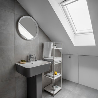 Photo of a small contemporary shower room bathroom in London with grey cabinets, grey tiles, white walls, a wall-mounted sink, grey floors, white worktops, a single sink and a built in vanity unit.