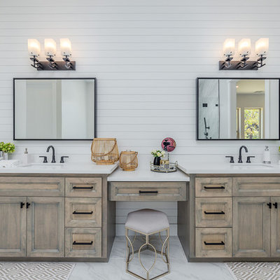 Inspiration for a cottage master gray floor and marble floor bathroom remodel in Sacramento with granite countertops, white countertops, recessed-panel cabinets, distressed cabinets, white walls and an undermount sink