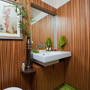 Inspiration for a midcentury modern glass tile and green tile mosaic tile floor and green floor bathroom remodel in Denver with brown walls, a wall-mount sink, medium tone wood cabinets and flat-panel cabinets