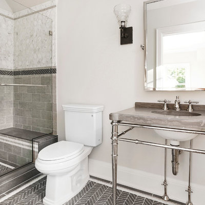 Inspiration for a mid-sized timeless white tile, gray tile and stone tile limestone floor alcove shower remodel in New York with a two-piece toilet, beige walls, marble countertops and a console sink