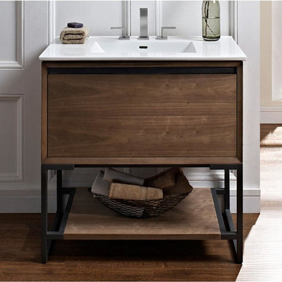 Example of a small transitional 3/4 light wood floor bathroom design in Philadelphia with flat-panel cabinets, light wood cabinets, white walls, a wall-mount sink and solid surface countertops