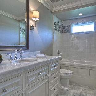 Beach style bathroom photo in Los Angeles with marble countertops