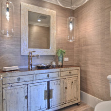 rustic bathroom by Spinnaker Development
