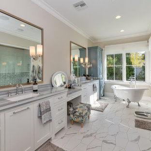 Example of a country white floor and double-sink bathroom design in Phoenix with beaded inset cabinets, white cabinets, beige walls, an undermount sink, a hinged shower door, gray countertops and a built-in vanity