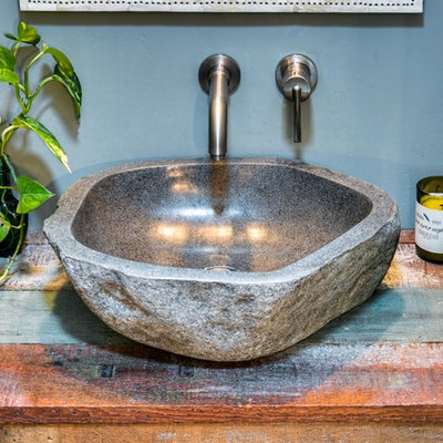 Inspiration for a small rustic 3/4 bathroom remodel in Boise with gray walls, a vessel sink and wood countertops