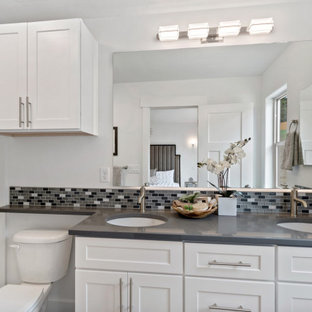 Inspiration for a small arts and crafts master bathroom with shaker cabinets, white cabinets, a built-in vanity, an open shower, multi-coloured tile, mosaic tile, engineered quartz benchtops, grey benchtops, a double vanity, a one-piece toilet, white walls, laminate floors, an undermount sink, grey floor and a shower curtain.