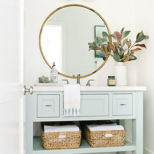 Beach style 3/4 cement tile floor and green floor bathroom photo in Los Angeles with furniture-like cabinets, green cabinets and white walls