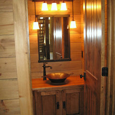Rustic Bathroom by Higgins Building Group, Inc.