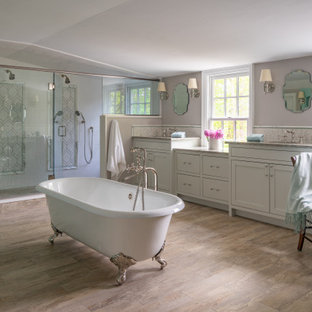 Example of a farmhouse master white tile brown floor bathroom design in Boston with shaker cabinets, gray cabinets, gray walls, a hinged shower door and gray countertops