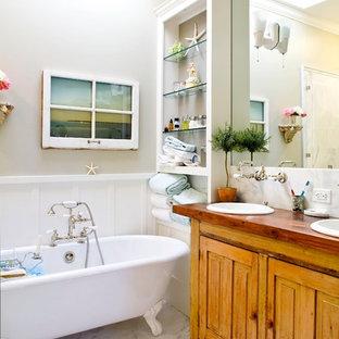 Неиссякаемый источник вдохновения для домашнего уюта: ванная комната в классическом стиле с ванной на ножках