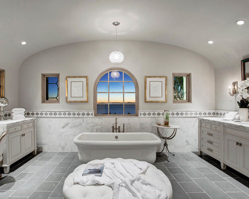 inspiration for a white tile gray floor bathroom remodel in los angeles with beaded inset