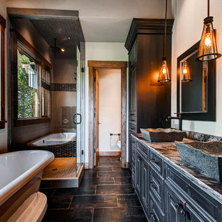 Freestanding Bathtub   Rustic Beige Floor Freestanding Bathtub Idea In  Denver With Black Cabinets