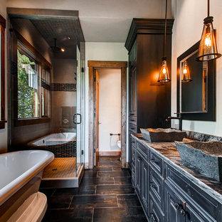 Freestanding Bathtub Rustic Beige Floor Idea In Denver With Black Cabinets