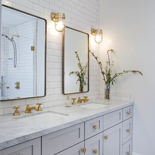 Inspiration for a transitional white tile and subway tile mosaic tile floor bathroom remodel in San Diego with shaker cabinets, white cabinets, white walls and an undermount sink