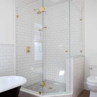 Arts and crafts 3/4 white tile and subway tile medium tone wood floor bathroom photo in San Diego with shaker cabinets, white cabinets, white walls, an undermount sink and a two-piece toilet