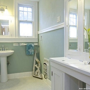 Bathroom - small mediterranean master white tile and porcelain tile ceramic floor bathroom idea in Austin with a pedestal sink, raised-panel cabinets, white cabinets, wood countertops, a one-piece toilet and green walls