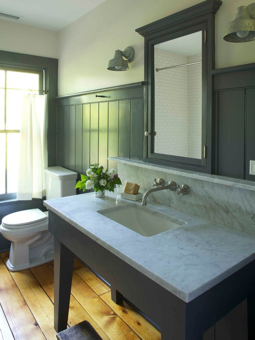 Inspiration For A Farmhouse Medium Tone Wood Floor Bathroom Remodel In New  York With Marble Countertops